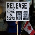 Protest sign calling for the release of Kovrig and Spavor.
